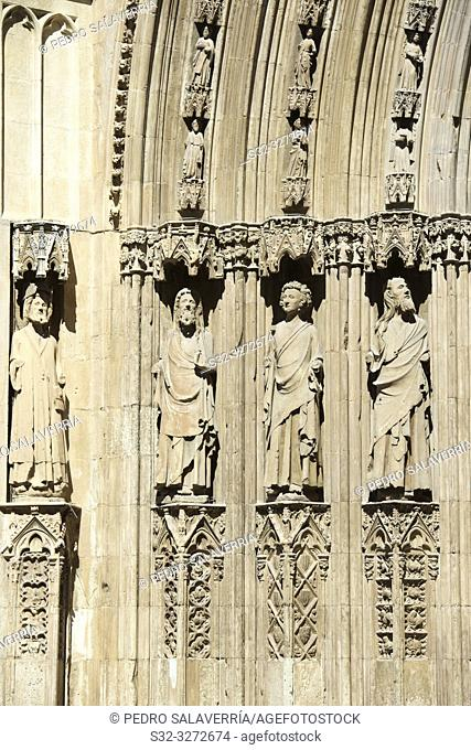 religious figures carved on the facade of Valencia Cathedral in Spain