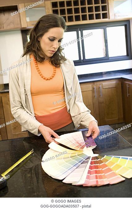 Woman choosing color samples