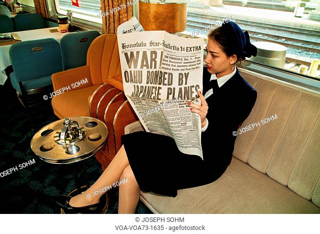 1940's reenactor reads December 12, 1941 newspaper on Pearl Harbor Day Troop train reenactment from Los Angeles Union Station to San Diego