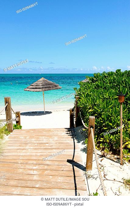 Boardwalk and parasol, Grace Bay, Providenciales, Turks and Caicos, Caribbean
