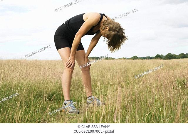 Exhausted woman runner resting