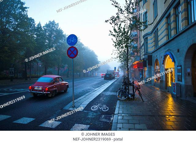Calm street in city during rain