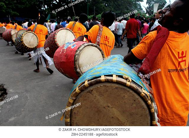 Thousands of Hindu devotees attend a procession during the celebration of the religious festival Janmashtami, marking the birth anniversary of Lord Sri Krishna