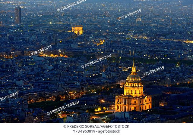 Aerial view of Paris by dusk. Illuminated Arc de Triomphe and Invalides in Paris,France,Europe