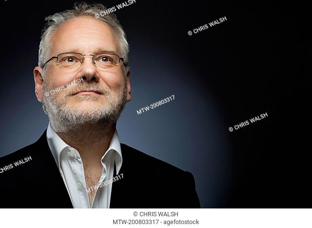 Portrait businessman 50 glasses suit mature smile