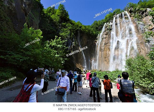 The Plitvice Lakes in the National Park Plitvicka Jezera in Croatia  Visitors taking fotos of the big waterfall of the national Park  The Plitvice Lakes are a...