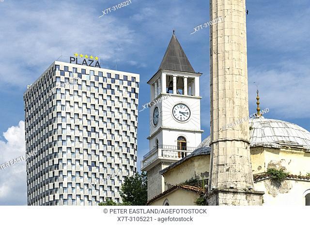 Three of Tirana's landmarks - The Et'hem Bey Mosque, the clock tower and the Plaza Hotel seen from Skanderbeg Square Tirana, Albania,
