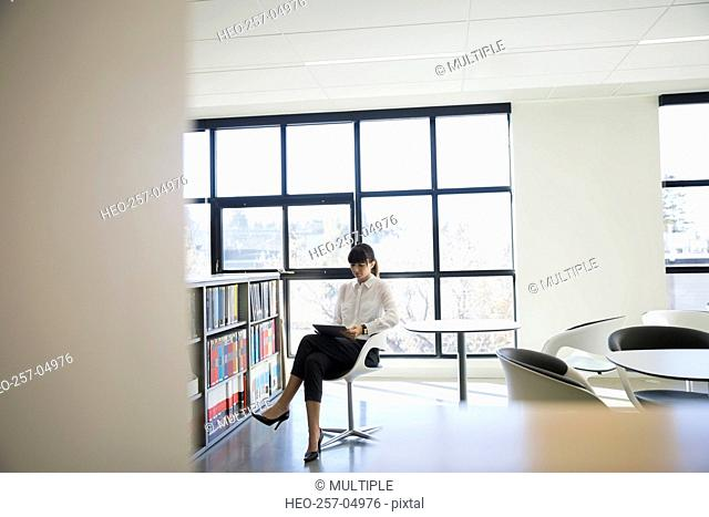 Businesswoman using digital tablet in office