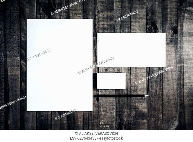 Photo of blank stationery set on wooden table background. Blank letterhead, business cards, envelope and pencil. Mockup for branding identity