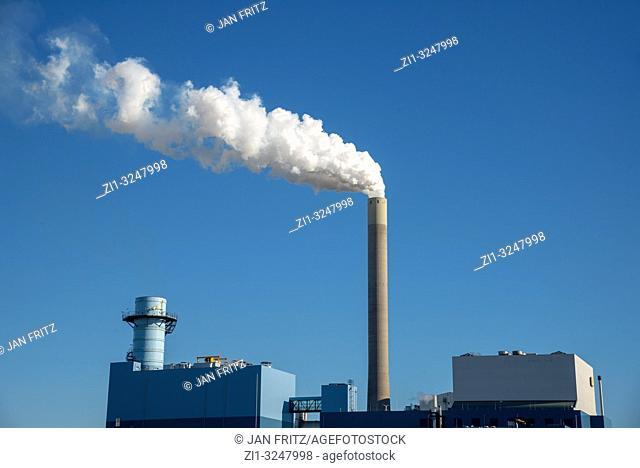 powerplant with smoking pipe and blue sky