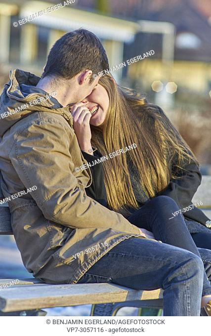 Tegernsee, Germany, couple sitting on bench