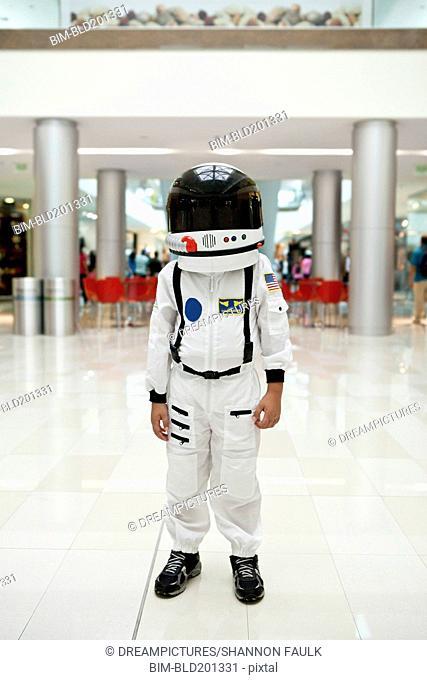 Boy in astronaut costume