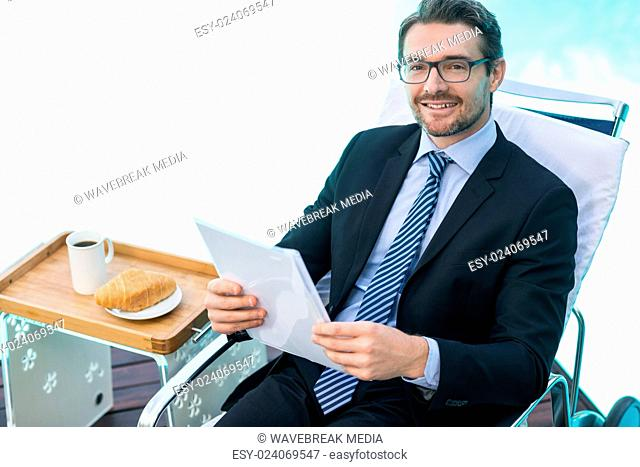 Smart man holding document near pool