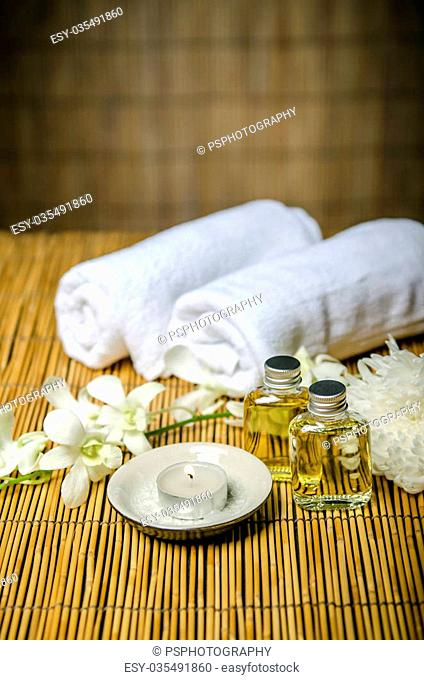 Massage concept, massage oil and white towels