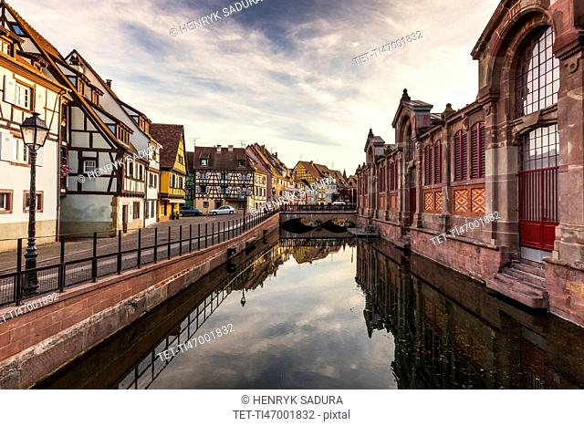 France, Grand Est, Colmar, Sky reflecting in water surface