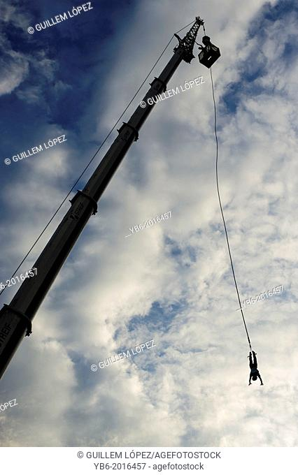 A person bungee Jumping during the Przystanek Woodstock - Europe's largest open air Music festival in Kostrzyn, Poland