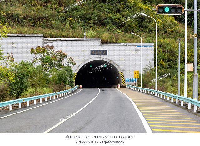 Guizhou, China. Modern Highway in Guizhou Province, Approaching Tunnel