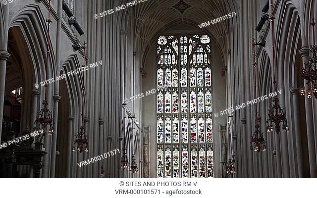 TILT up, interior, view from the Nave toward the East Window and the Choir ceiling. The Victorian 1837-1901 stained glass window depicts 56 events in the life...