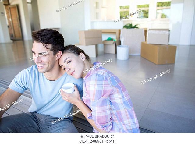 Couple drinking coffee in new house