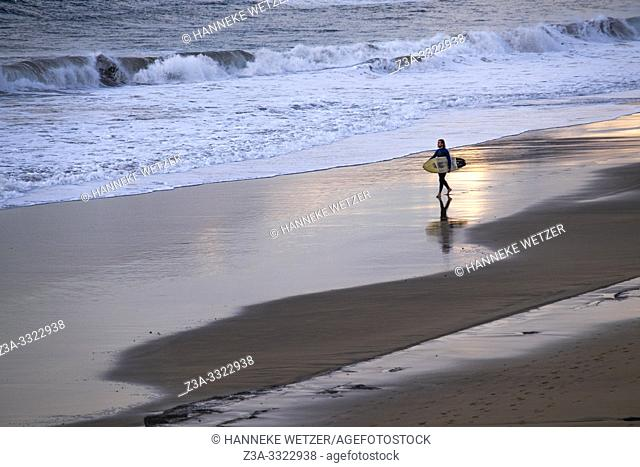 Surfer walking in the shore. Gran Canaria, Canary Islands, Spain