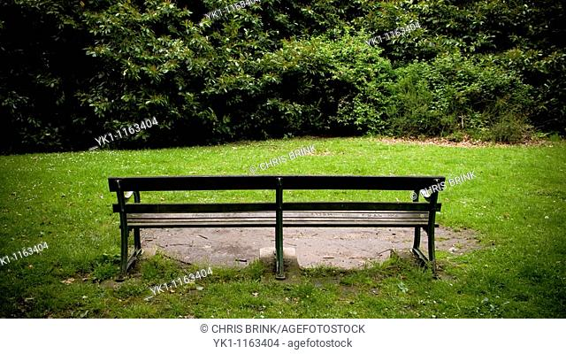 Empty bench with blocked view in park