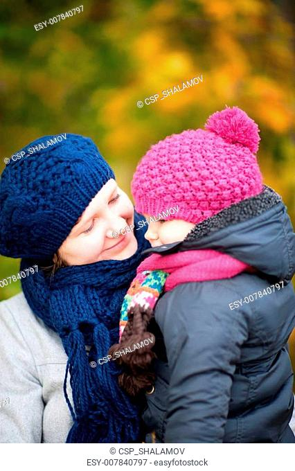 Mother and daughter at autumn park