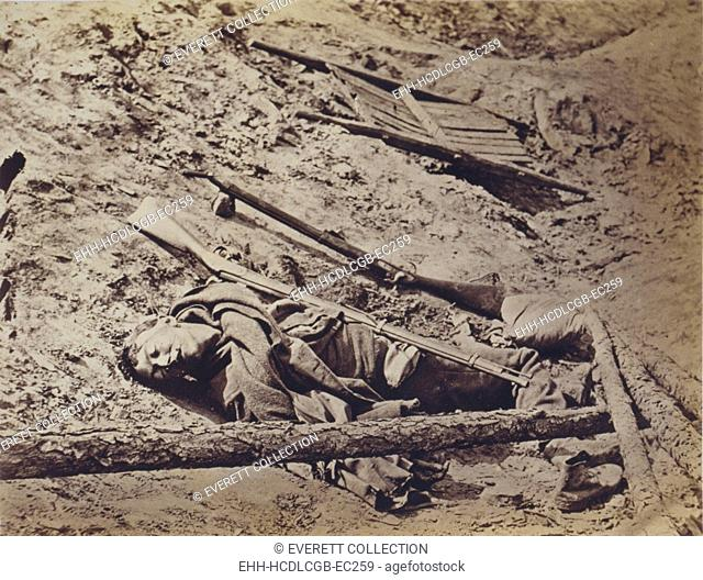 The Civil War, dead Confederate soldier lying in a trench, Petersburg, Virginia, April 3, 1865