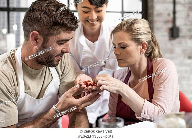 Couple tasting seeds in cooking class
