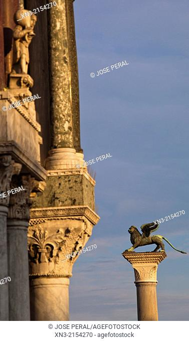 At left Saint Mark's Basilica, Winged Lion column, St Mark's square, Venice, Veneto, Italy, Europe