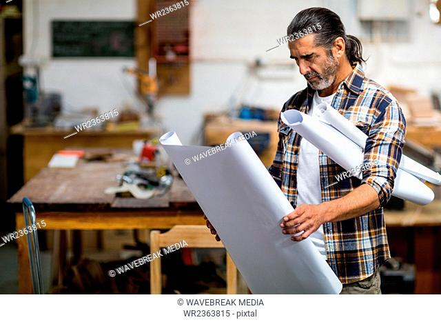Carpenter looking at a blueprint