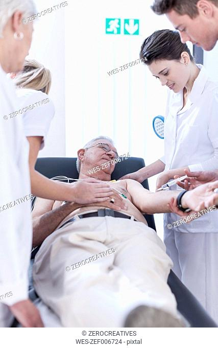 Senior man in hospital getting injection