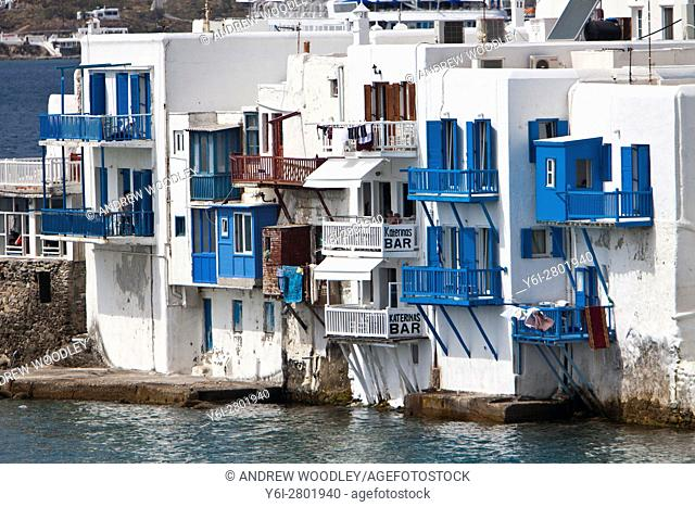 Blue balconies Mykonos Town waterfront Greece