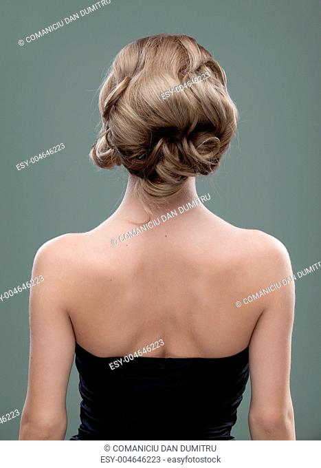 head and shoulders back image of a young woman with beautiful ha