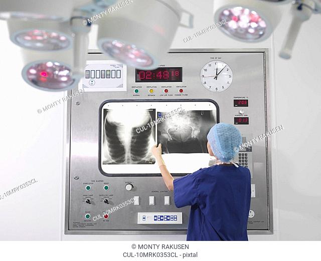 Nurse with x-rays in operating theatre