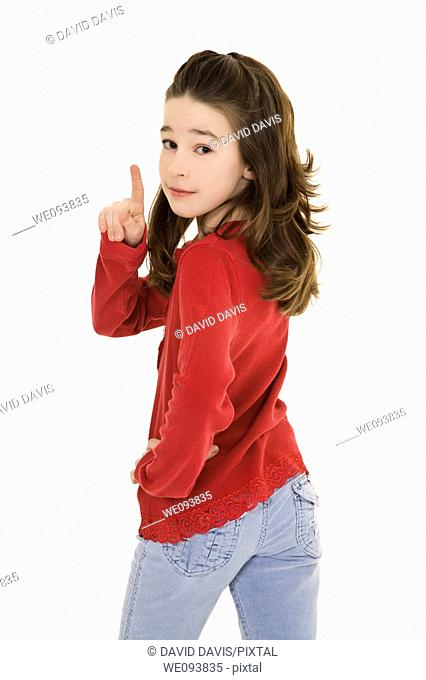 Caucasian preteen using her finger to display some attitude