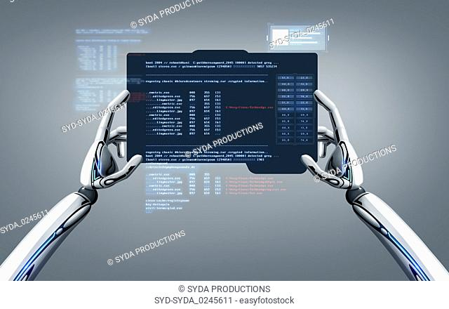 robot hands programming tablet pc over gray