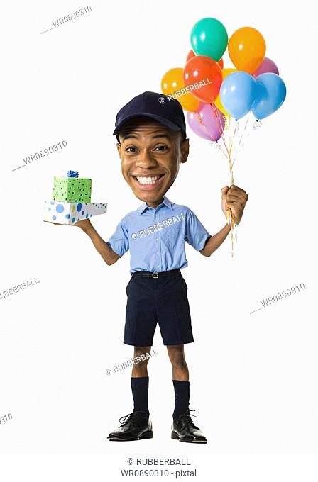 Portrait of a young man holding gifts and balloons