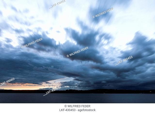Lake Starnberg with storm clouds at dusk, Bavaria, Germany