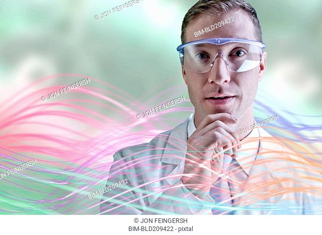 Caucasian scientist wearing safety goggles