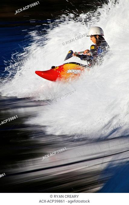 A young woman freestyle kayaking on Skookumchuk ocean rapids, Skookumchuck Narrows Provincial Park, Egmont, Britsh Columbia, Canada