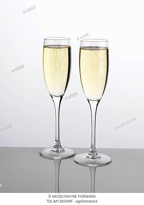 Two full glasses of champagne