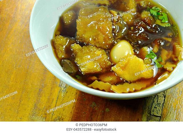 braised fish maw in red gravy soup on bowl