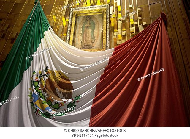 A big Mexican flag decorates the original image of the Virgin of Guadalupe at the pilgrimage to Our Lady of Guadalupe Basilica in Mexico City, Mexico