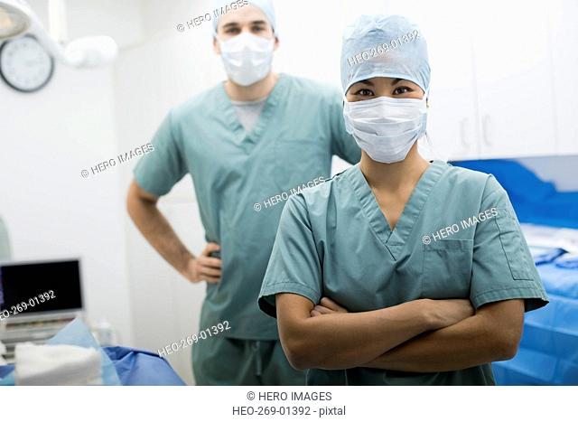 Portrait confident plastic surgeons in operating room