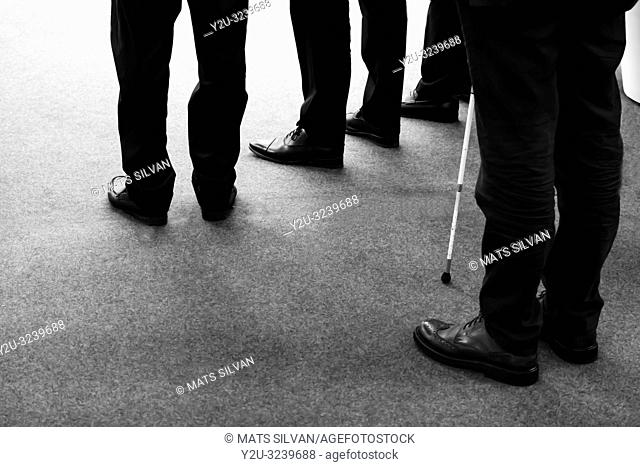 Low Section of Business Mens and One Blind Man white Stick