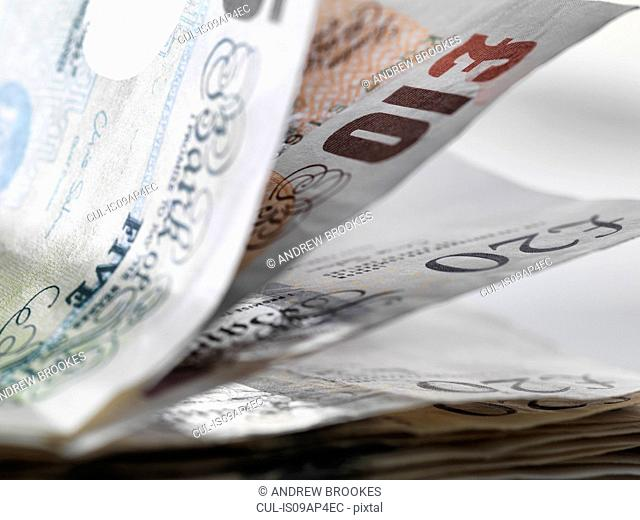 Close up detail of a stack of British banknotes
