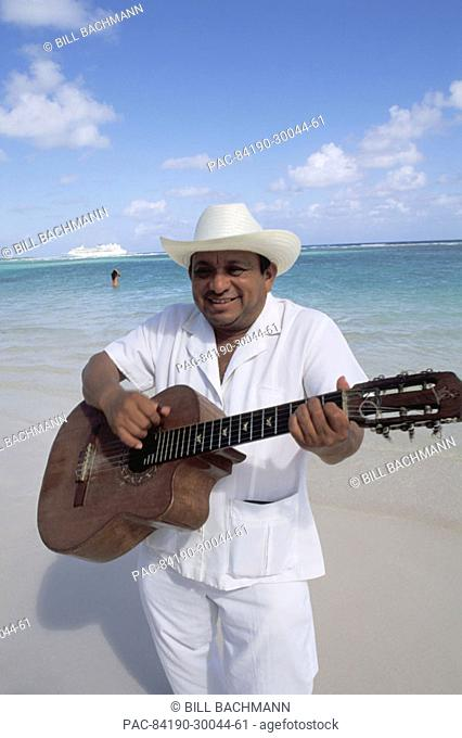 Mexico, Yucatan Peninsula, Costa Maya, Mariachi guitar player on beach