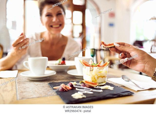 Businesswomen eating dessert in restaurant