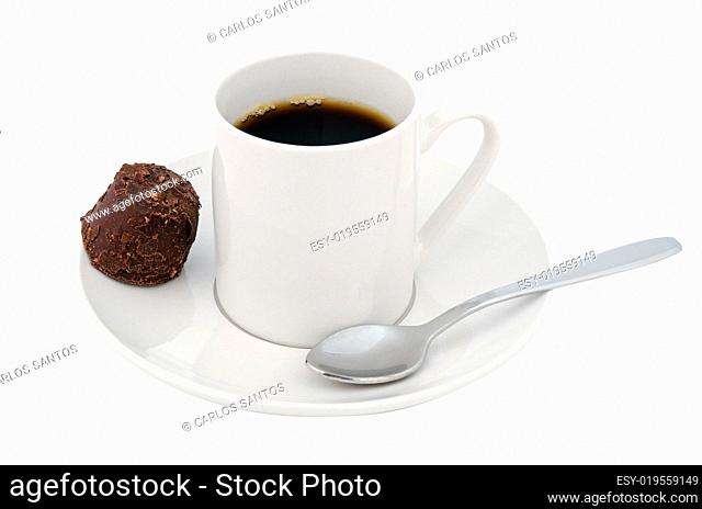 Coffee cup and chocolate sweet