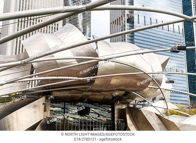 USA, IL, Chicago. High rise office towers of the Chicago skyline viewed through the complex metalwork of the Jay Pritzker Pavillion
